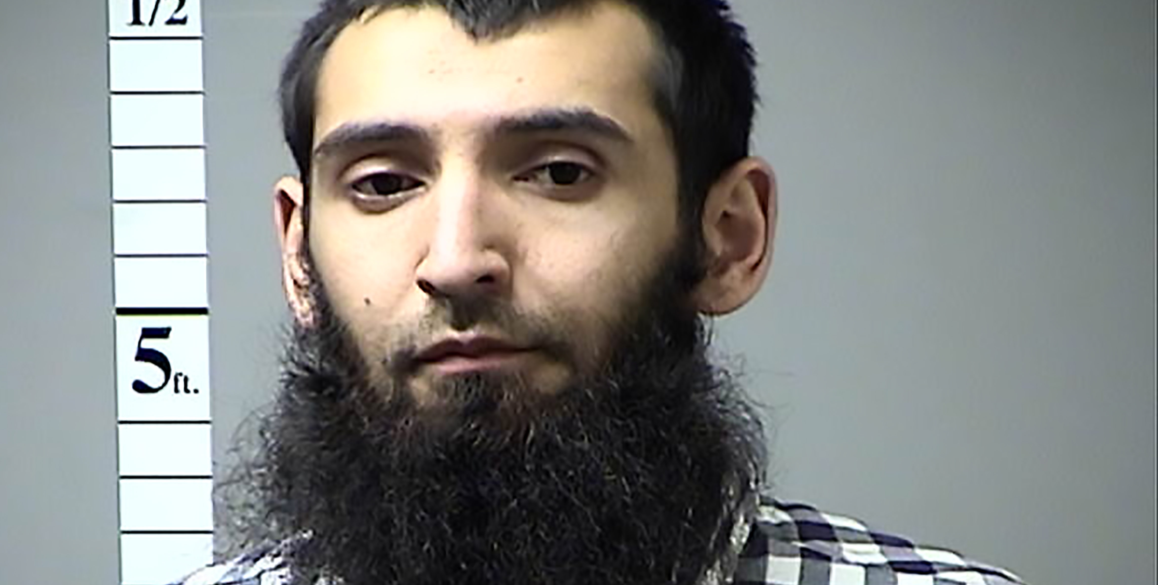 "This handout photograph obtained courtesy of the St. Charles County Dept. of Corrections in the midwestern US state of Missouri on October 31, 2017 shows Sayfullah Habibullahevic Saipov, the suspectecd driver who killed eight people in New York on October 31, 2017, mowing down cyclists and pedestrians, before striking a school bus in what officials branded a ""cowardly act of terror.""   Eleven others were seriously injured in the broad daylight assault and first deadly terror-related attack in America's financial and entertainment capital since the September 11, 2001 Al-Qaeda hijackings brought down the Twin Towers. In April of 2016 a warrant was issued in Missouri for his failure to pay a traffic citation.   / AFP PHOTO / St. Charles County Dept. of Corrections / == RESTRICTED TO EDITORIAL USE  / MANDATORY CREDIT:  ""AFP PHOTO /  ST. CHARLES COUNTY DEPT. OF CORRECTIONS"" / NO MARKETING / NO ADVERTISING CAMPAIGNS /  DISTRIBUTED AS A SERVICE TO CLIENTS  ==         (Photo credit should read ST. CHARLES COUNTY DEPT. OF CORR/AFP/Getty Images)"