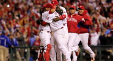 Roy Halladay and Carlos Ruiz of the Philadelphia Phillies celebrating Halladay's no-hitter and the win in Game 1 of the NLDS against the Cincinnati Reds in October 2010 in Philadelphia. (Photo by Chris Trotman/Getty Images)