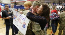 Mona and Gavin Shaw, 5, hug Master Sergeant Adam Shaw during a Welcome Home Ceremony for approximately 230 4th Brigade Combat Team soldiers, in November 2012 in Fort Carson, Colorado. (Photo by Marc Piscotty/Getty Images)