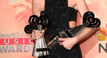 Taylor poses with her  iHeartRadio Music Awards which broadcasted live on NBC from The Shrine Auditorium in March 2015 in Los Angeles. (Photo Credit/Getty Images)