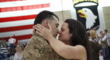 Sgt. Johnathan Link of the U.S. Army's Battery B, 2nd Battalion, 44th Air Defense Artillery Regiment, 101st Airborne Division, hugs his girlfriend Christine following a homecoming ceremony at Campbell Army Airfield in March 2014 in Fort Campbell, Kentucky. (Photo by Luke Sharrett/Getty Images)