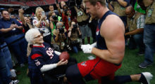 Asalee Poole who turned 99 on New Year's Eve meets Watt before they play against the Kansas City Chiefs during the AFC Wild Card Playoff game at NRG Stadium in January 2016 in Houston.  (Photo by Bob Levey/Getty Images)