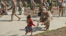Canee Copeland runs to hug her Dad Cpl Cade Copeland during a homecoming reception at Camp Pendleton in Oceanside, California in May 2017. (Photo credit/SANDY HUFFAKER/AFP/Getty Images)
