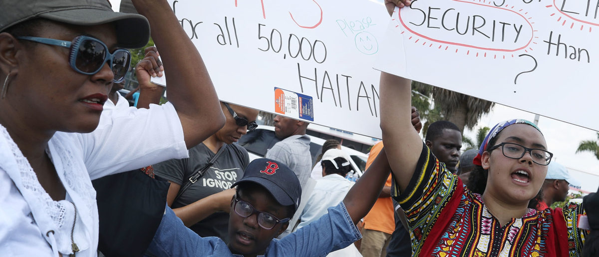 People protest the possibility that the Trump administration may overturn the Temporary Protected Status for Haitians in front of the U.S. Citizenship and Immigration Services office on May 13, 2017 in Miami, Florida. 50,000 Haitians have been eligible for TPS and now the Trump administration has until May 23 to make a decision on extending TPS for Haitians or allowing it to expire on July 22 which would mean possibly deportation for the current TPS holders. (Photo by Joe Raedle/Getty Images)