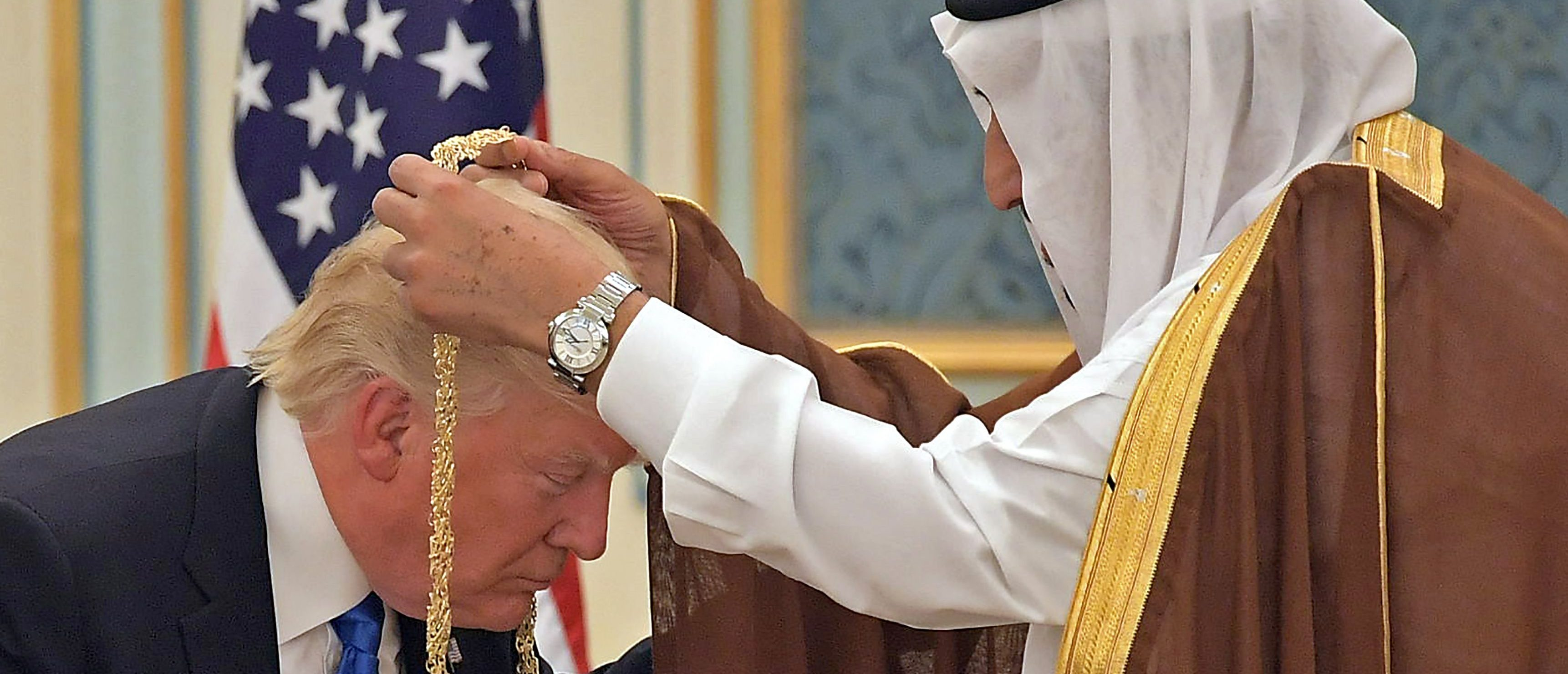 TOPSHOT - US President Donald Trump (C) receives the Order of Abdulaziz al-Saud medal from Saudi Arabia's King Salman bin Abdulaziz al-Saud (R) at the Saudi Royal Court in Riyadh on May 20, 2017. MANDEL NGAN/AFP/Getty Images