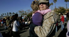 Staff Sgt. Robert Jones gives his daughter Rebecca a hug  during a homecoming ceremony for members of the 1st Marine Expeditionary Force in February 2007. (Photo by Sandy Huffaker/Getty Images)