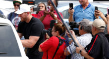 Watt hands out relief supplies to people impacted by Hurricane Harvey in September  2017, in Houston, Texas. (Photo by Brett Coomer - Pool/Getty Images)