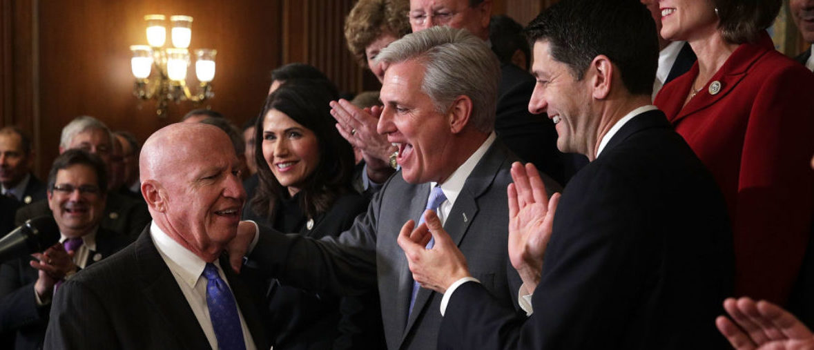 WASHINGTON, DC - NOVEMBER 16: (L-R) U.S. House Ways and Means Committee Chairman Rep. Kevin Brady (R-TX) is greeted by applause from (L-R) Rep. Kristi Noem (R-SD), House Majority Leader Rep. Kevin McCarthy (R-CA), and Speaker of the House Rep. Paul Ryan (R-WI) during an event at the Capitol to celebrate the passing of the tax reform bill November 16, 2017 in Washington, DC. The House has passed the tax reform bill with the vote 227 Ð 205. (Photo by Alex Wong/Getty Images)