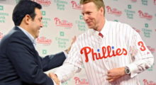 Halladay of the Philadelphia Phillies shakes hands with senior vice president and general manager Ruben Amaro, Jr. after signing with the the team in December 2009 at Philadelphia, Pennsylvania. (Photo by Drew Hallowell/Getty Images)