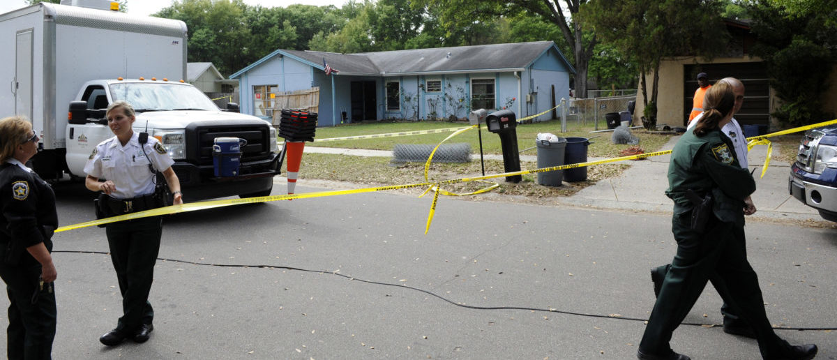 Hillsborough County Sheriff's deputies secure the scene surrounding a home where a sinkhole opened up and swallowed a man in Seffner, Florida, March 1, 2013. The 36-year-old Florida man was feared dead on Friday after the sinkhole suddenly opened beneath the bedroom of his suburban Tampa home swallowing him, police and fire officials said. Rescuers responded to a 911 call late on Thursday after the man's family reported hearing a loud crash in the house and rushed to his bedroom. REUTERS/Brian Blanco