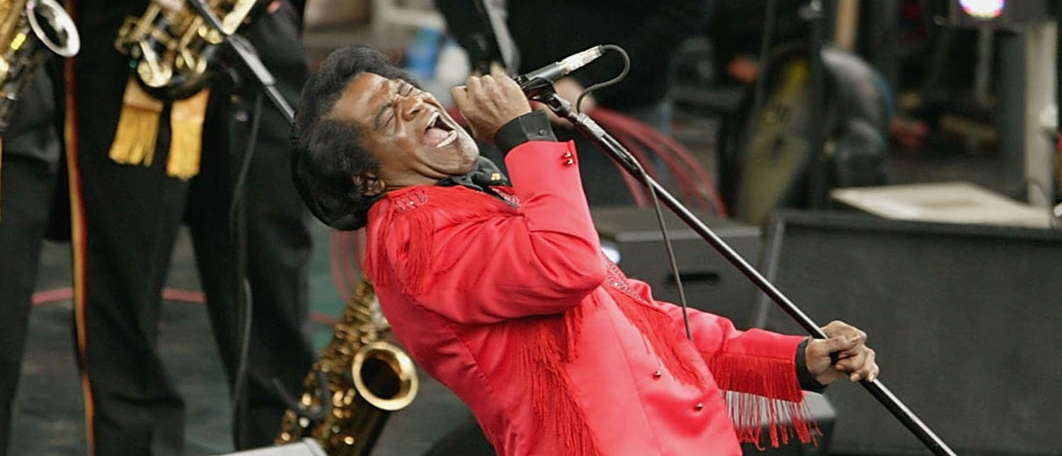 LONDON - JUNE 26: Singer James Brown performs on stage at the Olympic Torch Concert held in The Mall on June 26, 2004 in London. The free concert - organised by Visit London and The Greater London Authority is to celebrate the arrival of the Olympic torch in London. (Photo by Getty Images) *** Local Caption *** James Brown