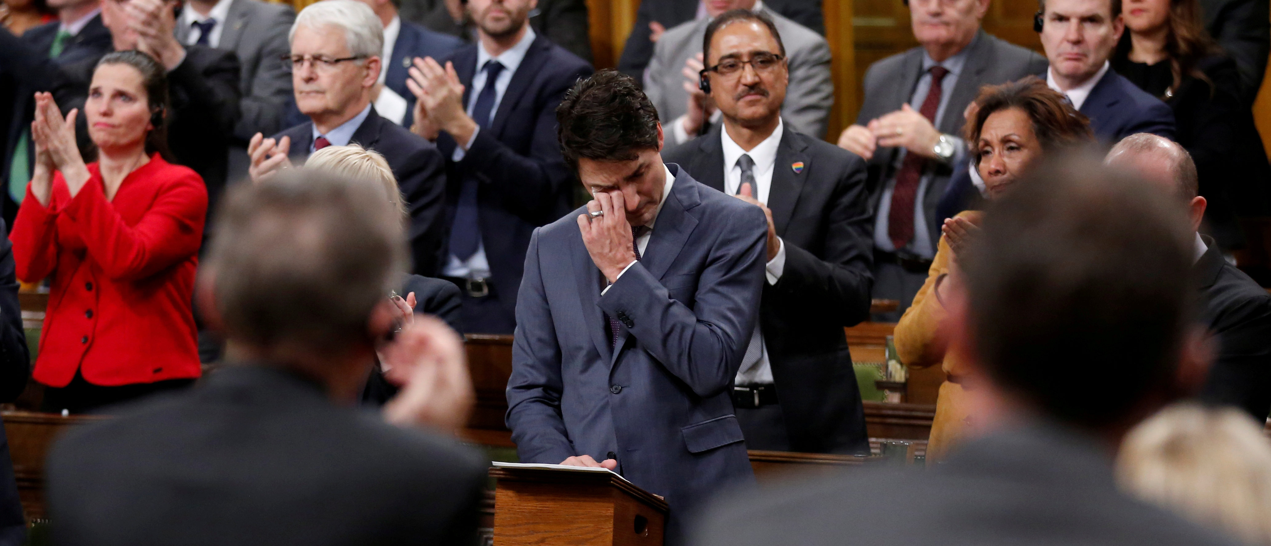 Canada's Prime Minister Justin Trudeau wipes away tears while delivering an apology to members of the LGBT community who were discriminated against by federal legislation and policies, in the House of Commons on Parliament Hill in Ottawa, Ontario, Canada, November 28, 2017. REUTERS/Chris Wattie