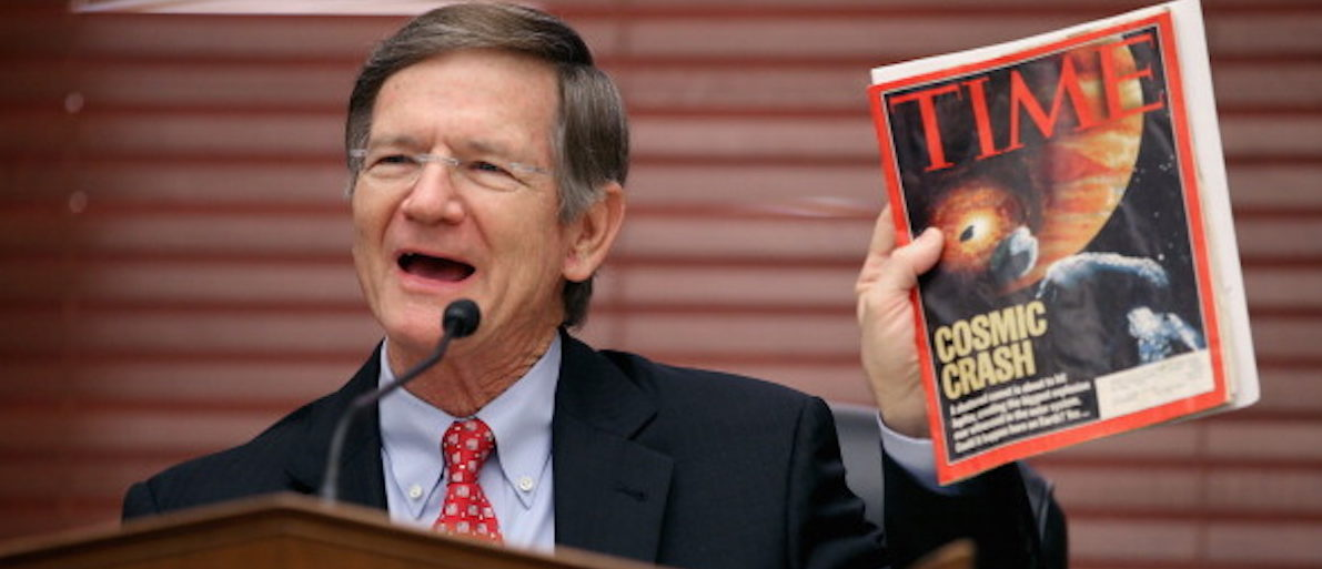 WASHINGTON, DC - MARCH 19: House Science, Space and Technology Committee Chairman Lamar Smith (R-TX) holds up a copy of TIME Magazine with a cover article about 'near-Earth objects' during a hearing in the Rayburn House Office Building on Capitol Hill March 19, 2013 in Washington, DC. The committee asked government and military experts about efforts to track and mitigate asteroids and meteors. (Photo by Chip Somodevilla/Getty Images)
