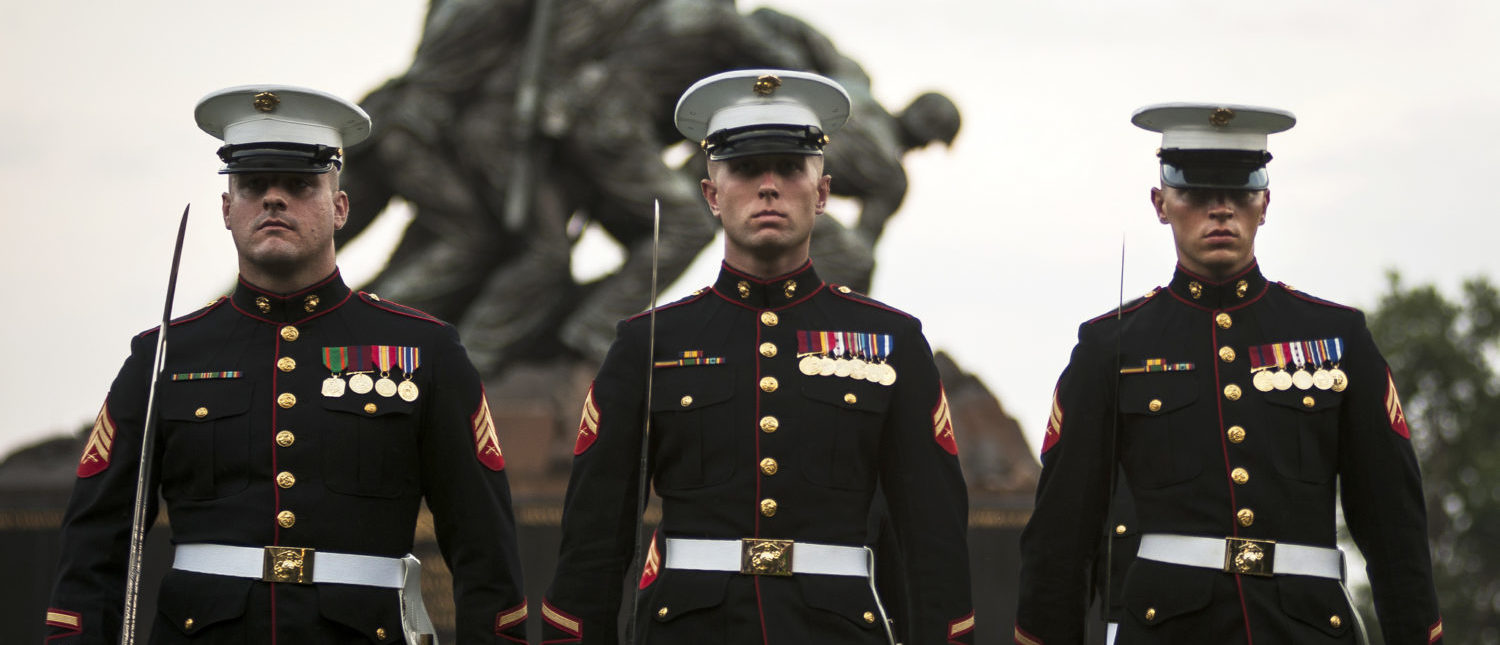 Three noncommissioned officers from Marine Barracks, Washington at 8th & I, perform during a Tuesday Sunset Parade at the Marine Corps War Memorial in Arlington, Va., July 30, 2013. (Flickr/Marine Corps/Lance Cpl. Dan Hosack/Released)