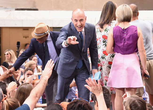 """Al Roker and Matt Lauer of NBC's """"Today"""" greet fans at Rockefeller Plaza on June 23, 2016 in New York City. (Photo by Larry Busacca/Getty Images)"""