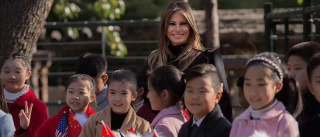 First lady Melania Trump poses for a photograph after she presented stuffed toy eagles, from the U.S., to children at the Beijing Zoo in Beijing on November 10, 2017. (Photo: NICOLAS ASFOURI/AFP/Getty Images)