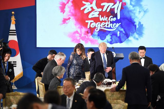 "US President Donald Trump (centre R) and First Lady Melania Trump (centre L) arrive for a state dinner with South Korea's President Moon Jae-In at the presidential Blue House in Seoul on November 7, 2017. North Korea poses a worldwide threat that requires worldwide action, President Donald Trump said in Seoul on November 7, but insisted ""we are making a lot of progress"" in reining in the rogue state. / AFP PHOTO / Jim WATSON (Photo credit should read JIM WATSON/AFP/Getty Images)"