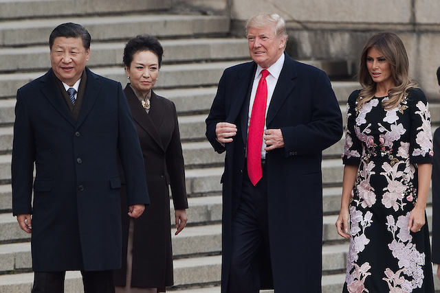 US President Donald Trump (C), First Lady Melania Trump (R), China's President Xi Jinping (L) and his wife Peng Liyuan (2nd L) attend a welcome ceremony at the Great Hall of the People in Beijing on November 9, 2017. / AFP PHOTO / NICOLAS ASFOURI (Photo credit should read NICOLAS ASFOURI/AFP/Getty Images)