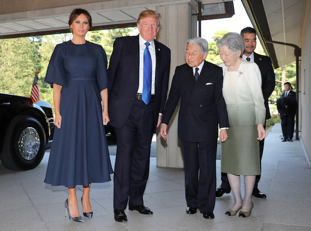 U.S. President Donald Trump, second right, and First Lady Melania Trump, left, are welcomed by Emperor Akihito, second right, and Empress Michiko, right, upon their arrival at the Imperial Palace Monday, Nov. 6, 2017 in Tokyo. REUTERS/Eugene Hoshiko/Pool - RC19FD6E0DF0