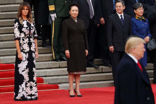 U.S. first lady Melania Trump and China's First Lady Peng Liyuan watch as U.S. President Donald Trump takes part in a welcoming ceremony with China's President Xi Jinping in Beijing, China, November 9, 2017. REUTERS/Damir Sagolj - RC15832548C0