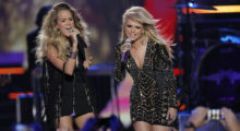 "Singers Carrie Underwood (L) and Miranda Lambert perform ""Somethin' Bad"" during the 2014 CMT Music Awards in Nashville, Tennessee June 4, 2014.   REUTERS/Harrison McClary (UNITED STATES  - Tags: ENTERTAINMENT)   - TB3EA6508OQB3"