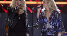 "Miranda Lambert and Carrie Underwood (R) perform ""Travelin' Band"" at the 45th annual Academy of Country Music Awards in Las Vegas, Nevada, April 18, 2010.     REUTERS/Robert Galbraith (UNITED STATES - Tags: ENTERTAINMENT) - GM1E64J0P0R01"