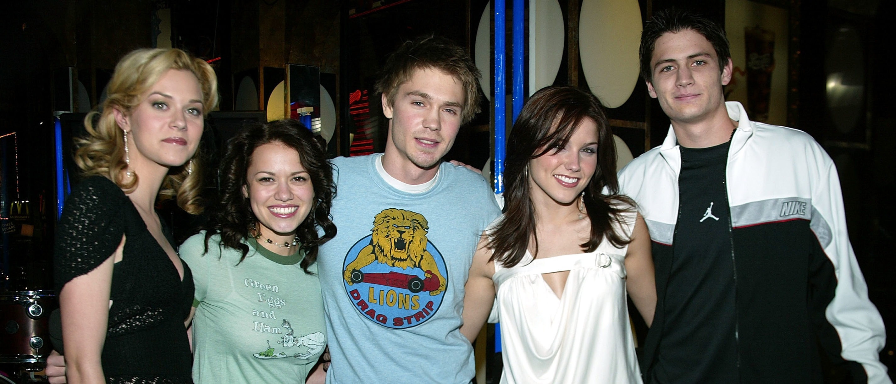 """(Left to right) The cast of """"One Tree Hill,"""" Hilarie Burton, Chad Michael Murray, Sophia Bush, Bethany Joy Lenz, and James Lafferty  on stage during """"TRL BreakOut Stars Week"""" on MTV's Total Request Live held on January 16, 2004 at the MTV Times Square Studios, in New York City. (Photo by Frank Micelotta/Getty Images)"""