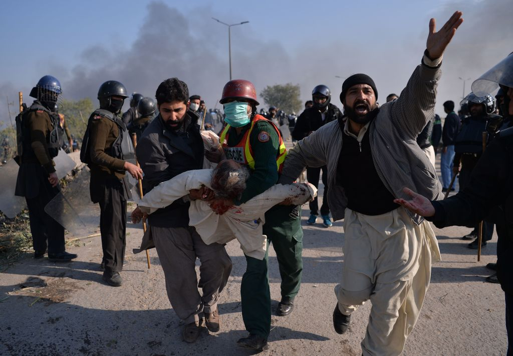 An injured activist from the Tehreek-i-Labaik Yah Rasool Allah Pakistan (TLYRAP) religious group is carried away from clashes with police in Islamabad on November 25, 2017. Pakistani forces fired rubber bullets and lobbed tear gas at protesters in Islamabad. (Photo: AAMIR QURESHI/AFP/Getty Images)