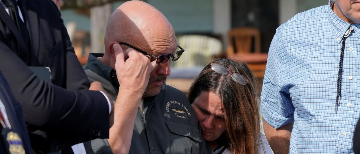 Pastor Frank Pomeroy, with his wife Sherri, listens at a news conference outside the site of the shooting at his church, the First Baptist Church of Sutherland, Texas, U.S., November 6, 2017. REUTERS/Rick Wilking