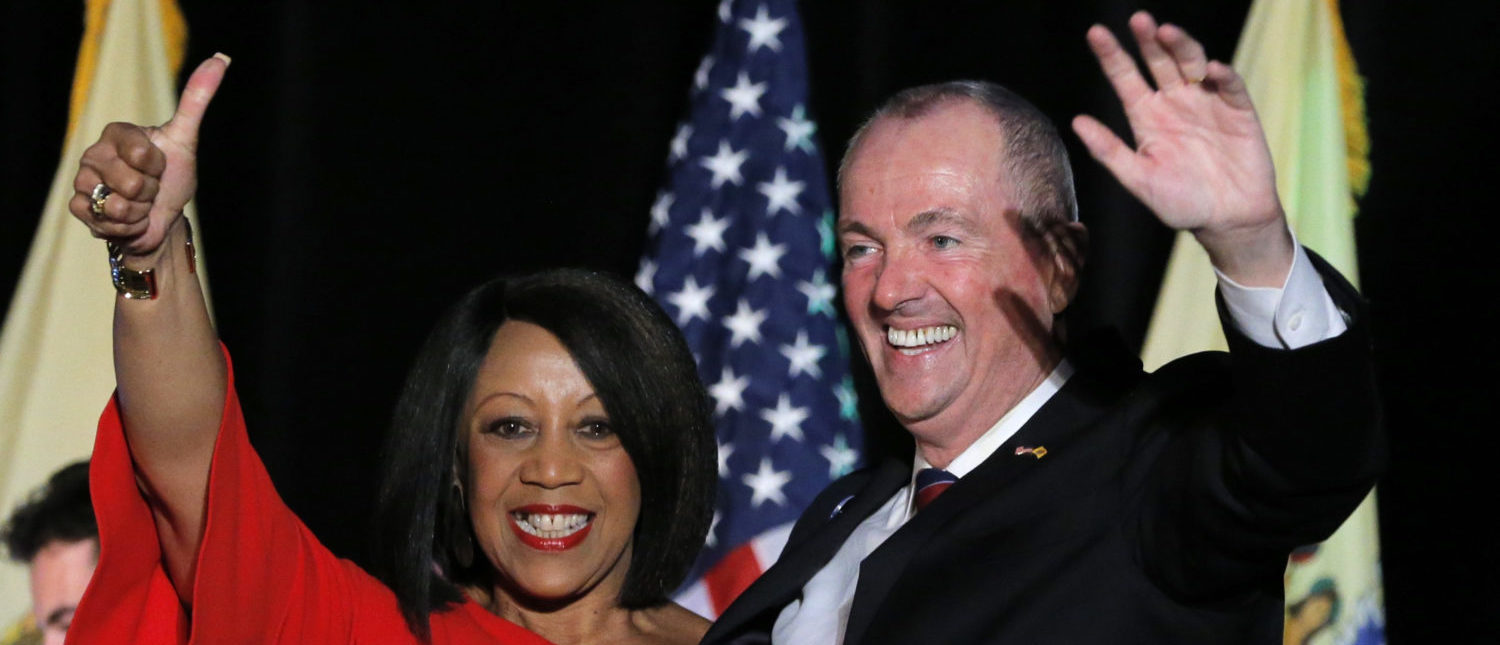 Democratic candidate Phil Murphy celebrates with his running mate, Lieutenant Governor-elect Sheila Oliver, after he was elected Governor of New Jersey, in Asbury Park, New Jersey, U.S., November 7, 2017. (REUTERS/Lucas Jackson)
