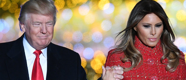 US President Donald Trump (L) and First lady Melania Trump walk on the stage during the 95th annual National Christmas Tree Lighting ceremony at the Ellipse in President's Park near the White House in Washington, DC on November 30, 2017. / AFP PHOTO / JIM WATSON (Photo credit should read JIM WATSON/AFP/Getty Images)