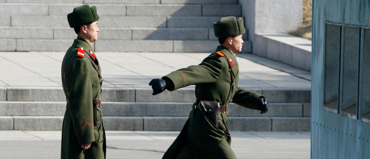 North Korean soldiers walk on the north part of the Joint Security Area at the truce village of Panmunjom in the demilitarized zone in Paju, 42 km (26 miles) northwest of Seoul, that separates North Korea from the South as a group of journalists attend a media tour organised by the United Nations Command February 20, 2008.  REUTERS/Lee Jae-Won
