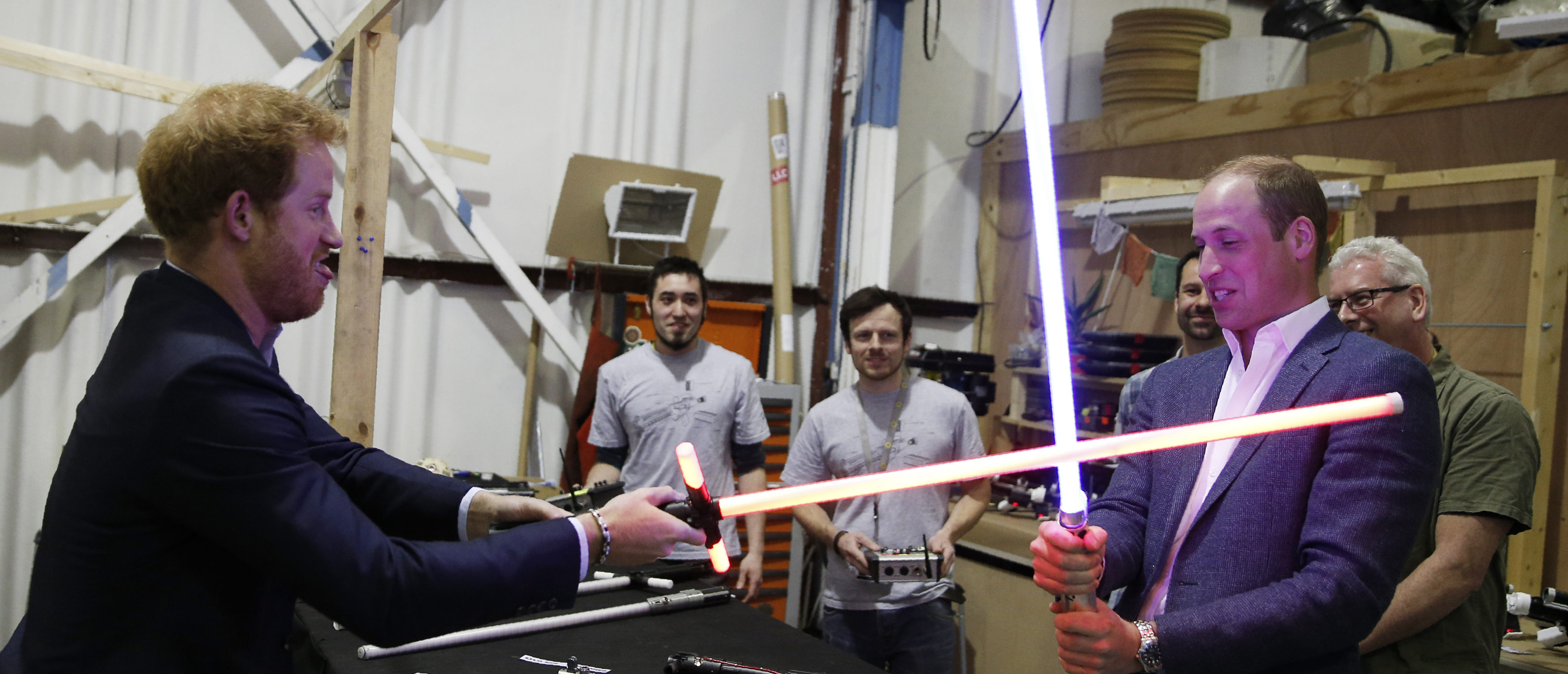 Britain's Prince William (R) tries a light sabre against his brother Prince Harry during a visit to the Star Wars film set at Pinewood Studios near Iver Heath, west of London, Britain, April 19, 2016. Prince William and Prince Harry are touring Pinewood to visit the production workshops and meet the creative teams working behind the scenes on the Star Wars films. REUTERS/Adrian Dennis/Pool - LR1EC4J135LJF