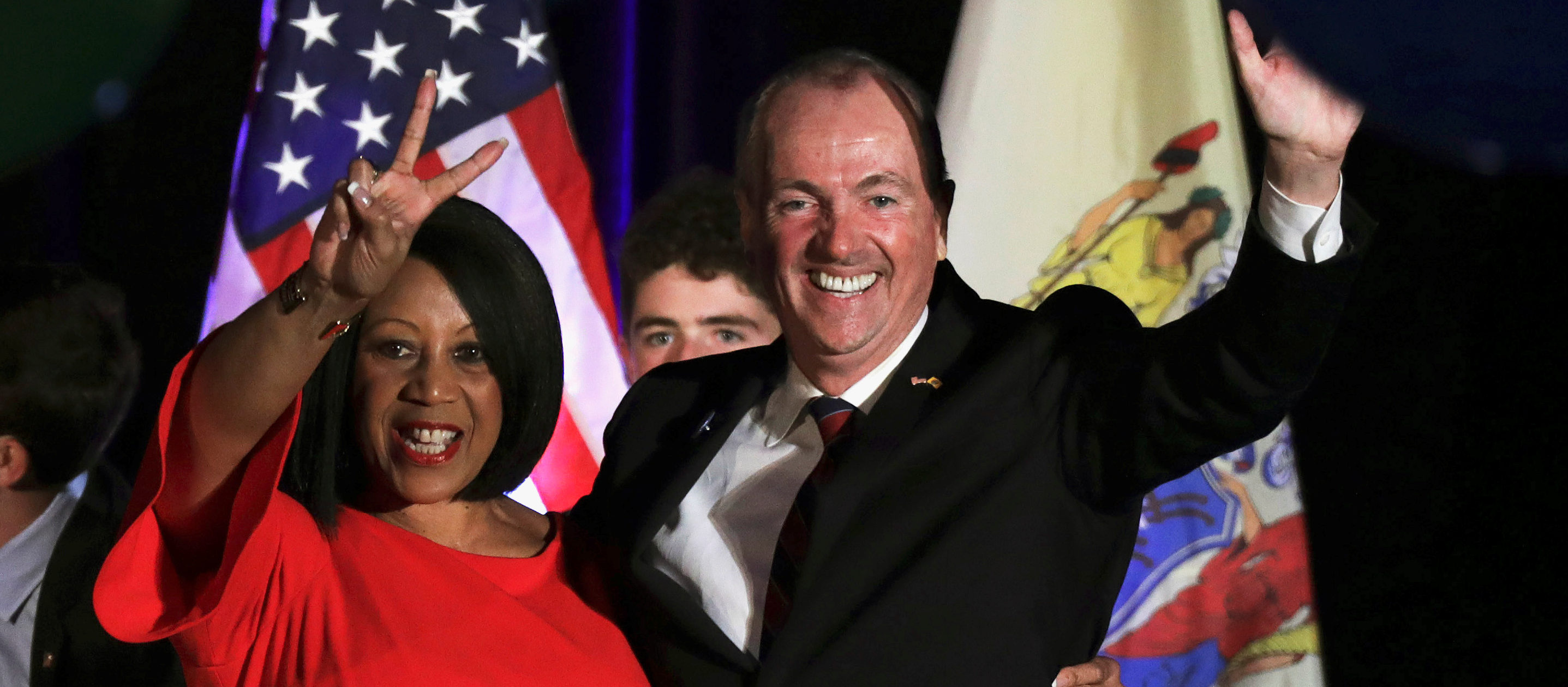 Phil Murphy, Governor-elect of New Jersey, and Shiela Oliver, Lieutenant Governor-elect, wave to supporters at their election night victory rally in Asbury Park, New Jersey, U.S., November 7, 2017. REUTERS/Dominick Reuter - RC1C736A2A80