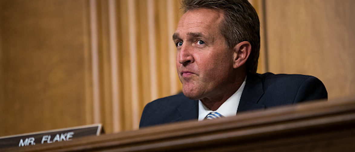 WASHINGTON, DC - OCTOBER 30: Sen. Jeff Flake (R-AZ) looks on during a Senate Foreign Relations Committee hearing concerning the authorizations for use of military force, October 30, 2017 in Washington, DC. As Mattis and Tillerson face questions about the administration's authority to use military force, Congress is still seeking more information about the deadly ambush that killed four U.S. troops in Niger. (Photo by Drew Angerer/Getty Images)