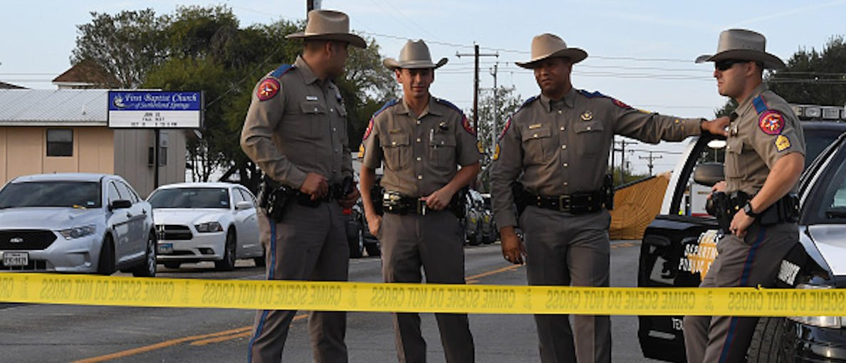 State troopers guard the entrance to the First Baptist Church (back) after a mass shooting that killed 26 people in Sutherland Springs, Texas on November 6, 2017. (Photo: MARK RALSTON/AFP/Getty Images)