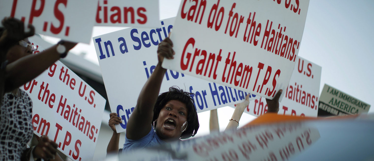 Members of the Haitian community shout slogans in favor of the Temporary Protected Status (TPS) for Haitian immigrants during a visit by U.S. President Barack Obama to Miami, Florida, October 26, 2009. REUTERS/Carlos Barria
