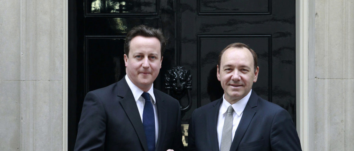 Britain's Prime Minister David Cameron poses with U.S. actor Kevin Spacey (R) on the steps of number 10 Downing Street in London February 18, 2011. Spacey, artistic director of the Old Vic Theatre collected a Big Society award for giving opportunities to young people in the arts. REUTERS/Luke MacGregor
