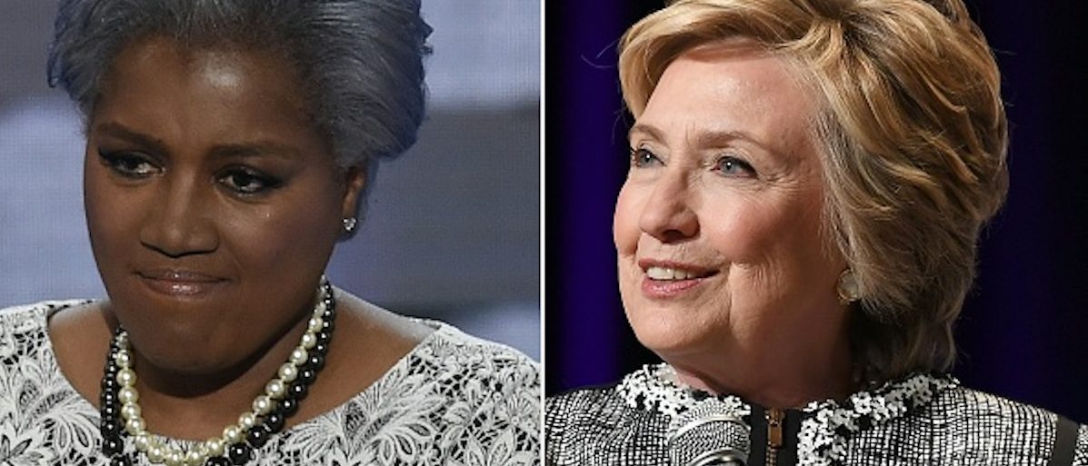 "(COMBO) This combination of files photos created on November 3, 2017 shows former DNC Vice-Chair Donna Brazile during Day 2 of the Democratic National Convention at the Wells Fargo Center in Philadelphia, Pennsylvania, July 26, 2016, and former former US  presidential candidate  Hillary Clinton onstage at ""An Evening with Hillary Rodham Clinton""  during the BookExpo on June 1, 2017 in New York.  Explosive revelations by a top Democratic operative that the 2016 primaries were tipped in Hillary Clinton's favor have convulsed the party as it struggles to rebuild, and whipped up accusations of cheating from President Donald Trump. Donna Brazile, the Democratic National Committee's interim chairwoman during key months of the presidential campaign, said Clinton's team essentially took over day-to-day operations of the DNC, in essence rigging the system against Senator Bernie Sanders, who was challenging Clinton for the party's nomination.   / AFP PHOTO / SAUL LOEB AND ANGELA WEISS        (Photo credit should read SAUL LOEB,ANGELA WEISS/AFP/Getty Images)"