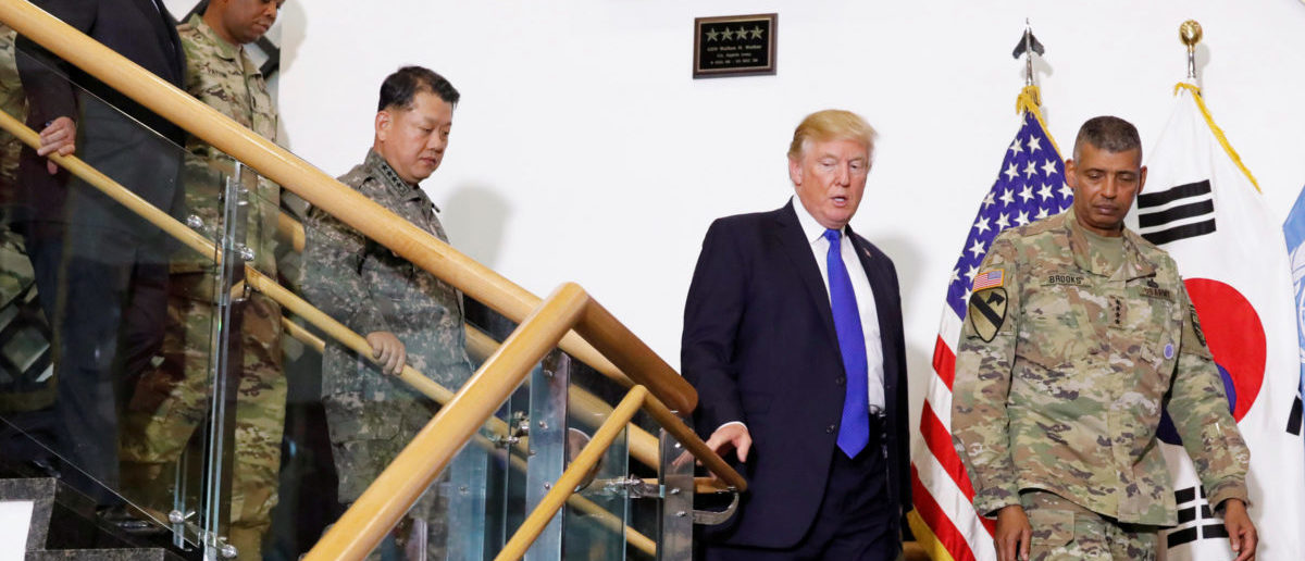 U.S. President Donald Trump walks with military commanders at the U.S. Eighth Army Operation Command Center at U.S. military installation Camp Humphreys in Pyeongtaek, South Korea, November 7, 2017. REUTERS/Jonathan Ernst