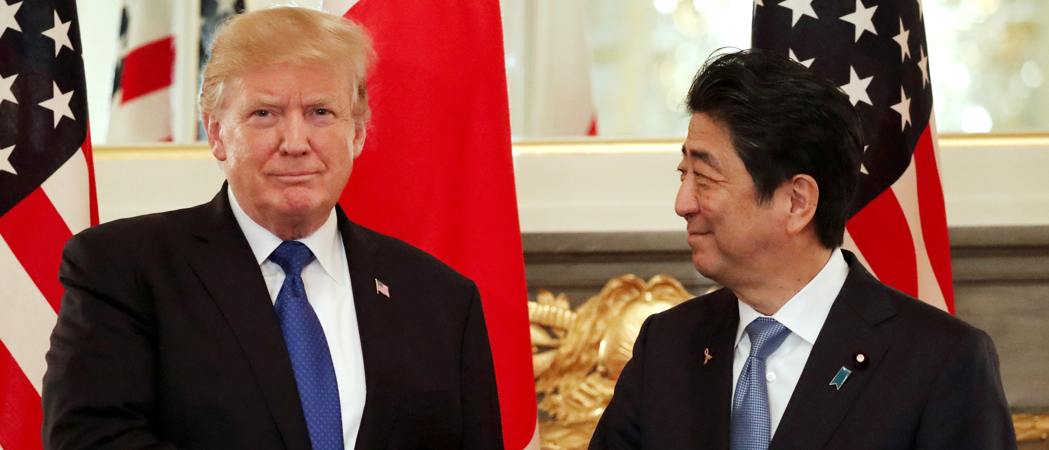 U.S. President Donald Trump and Japan's Prime Minister Shinzo Abe shake hands before a working lunch at Akasaka Palace in Tokyo, Japan November 6, 2017. REUTERS/Jonathan Ernst