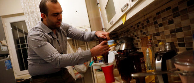 Onder Ceyhun, a 25-year old university student, brews his own beer at his home in Ankara, Turkey, November 6, 2017. REUTERS/Umit Bektas