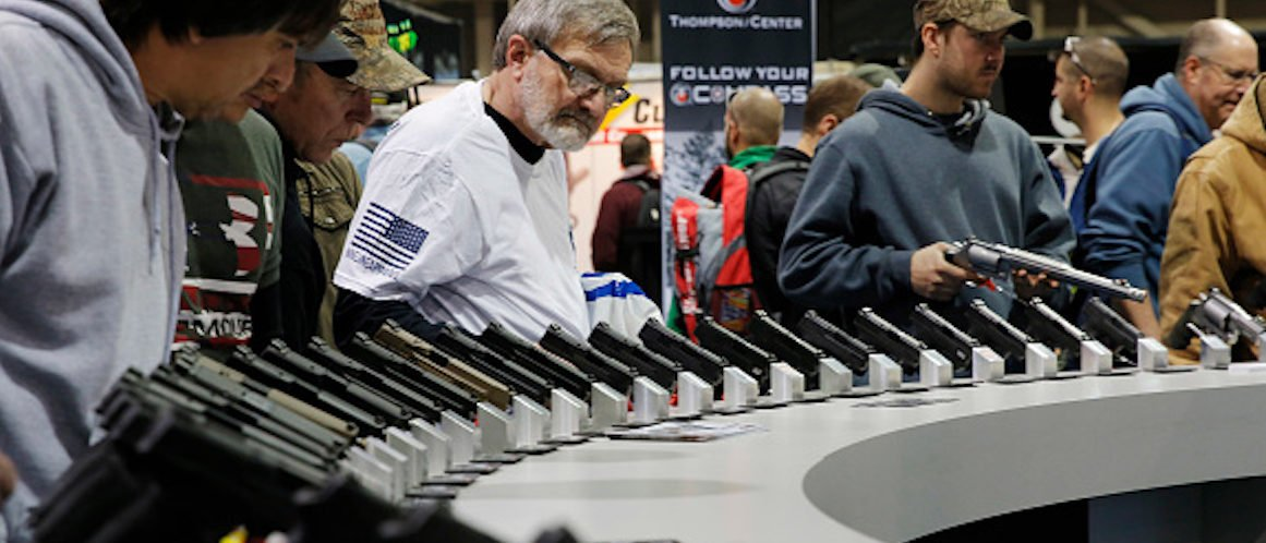 Visitors view gun displays at a National Rifle Association outdoor sports trade show on February 10, 2017 in Harrisburg, Pennsylvania. The Great American Outdoor Show, a nine day event celebrating hunting, fishing and outdoor traditions, features over 1,000 exhibitors ranging from shooting manufacturers to outfitters to fishing boats and RVs, and archery to art. / AFP PHOTO / DOMINICK REUTER (Photo credit should read DOMINICK REUTER/AFP/Getty Images)
