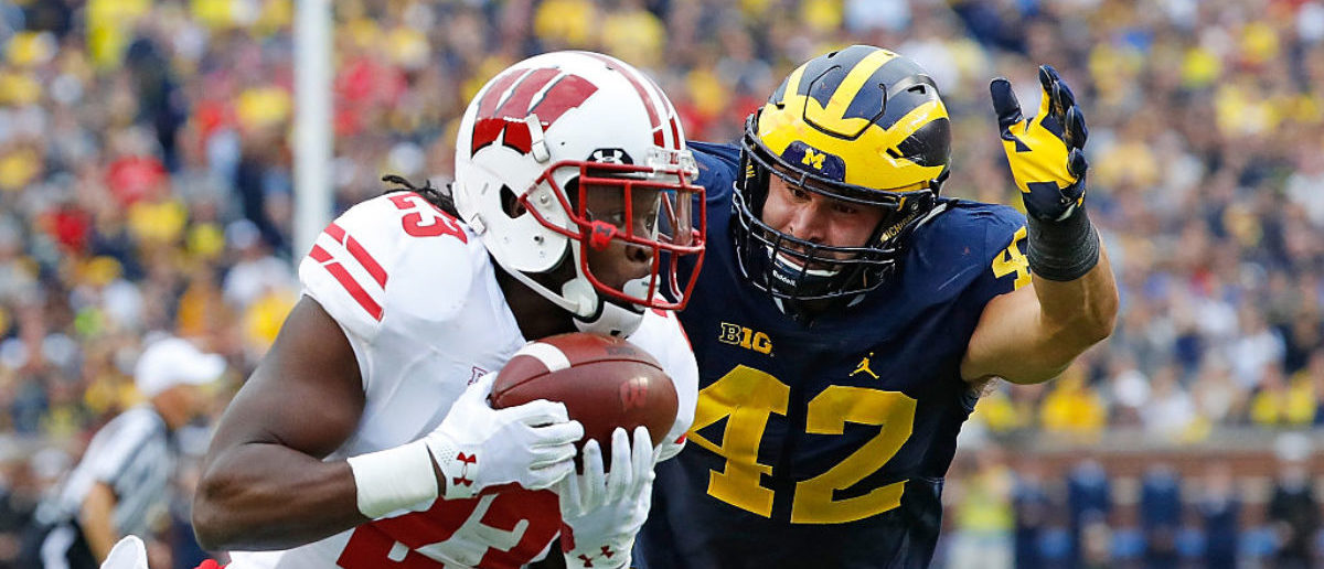 ANN ARBOR, MI - OCTOBER 01: Dare Ogunbowale #23 of the Wisconsin Badgers scores on a third quarter touchdown pass as Ben Gedeon #42 of the Michigan Wolverines defends at Michigan Stadium on October 1, 2016 in Ann Arbor, Michigan. (Photo by Leon Halip/Getty Images)