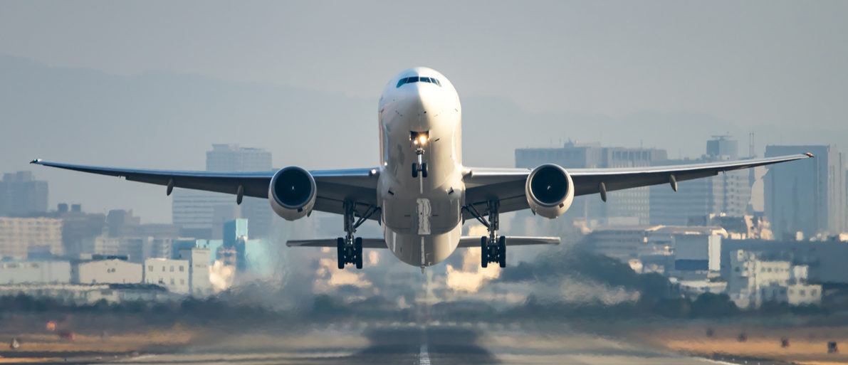Airplane taking off from the airport. Shutterstock/ Motive56