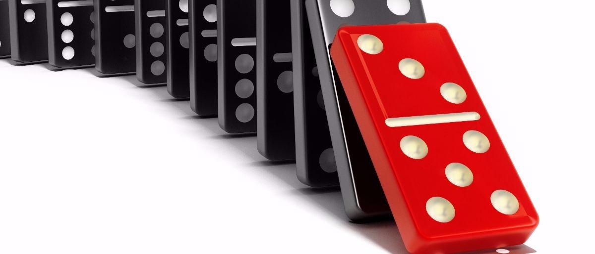 cause effect dominoes Shutterstock/cigdem
