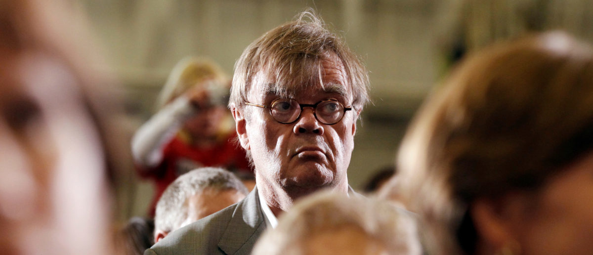 FILE PHOTO: Author and radio personality Garrison Keillor listens to U.S. President Barack Obama speak at a campaign rally in Minneapolis, Minnesota, U.S. October 23, 2010. REUTERS/Kevin Lamarque/File Photo