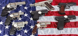 Here is a photo of guns and a flag. (Photo: Shutterstock/ja-images)