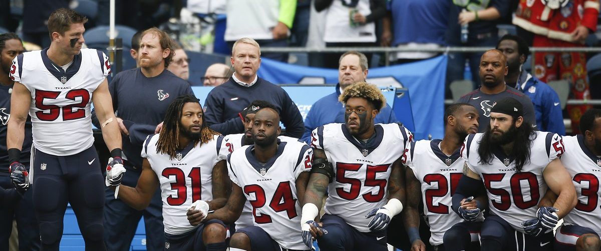 "Members of the Houston Texans stand and kneel before the game against the Seattle Seahawks at CenturyLink Field on October 29, 2017 in Seattle, Washington. During a meeting of NFL owners earlier in October, Houston Texans owner Bob McNair said ""we can't have the inmates running the prison"", referring to player demonstrations during the national anthem. Otto Greule Jr/Getty Images."