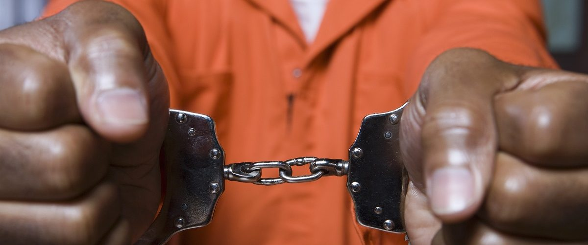 A black prisoner is in handcuffs. (sirtravelalot/Shutterstock)
